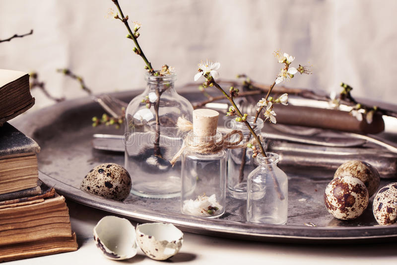 Easter interior with vials and quail eggs stock images