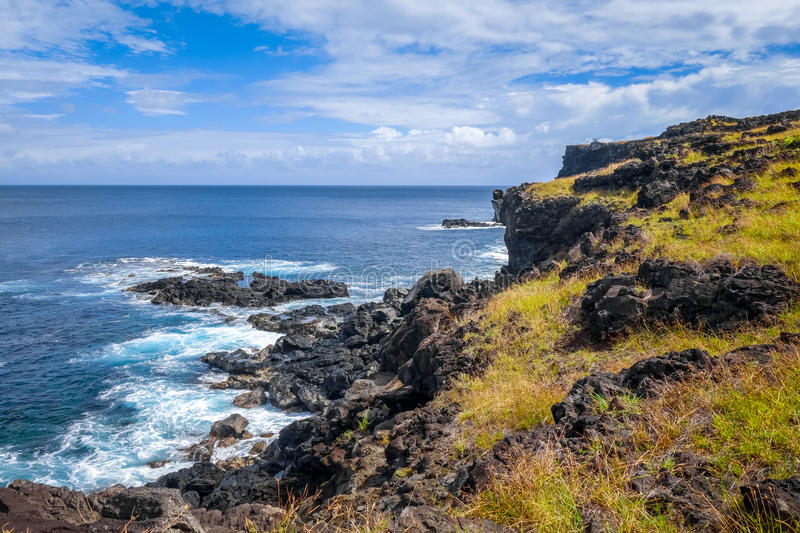 Easter island cliffs and pacific ocean landscape stock photo