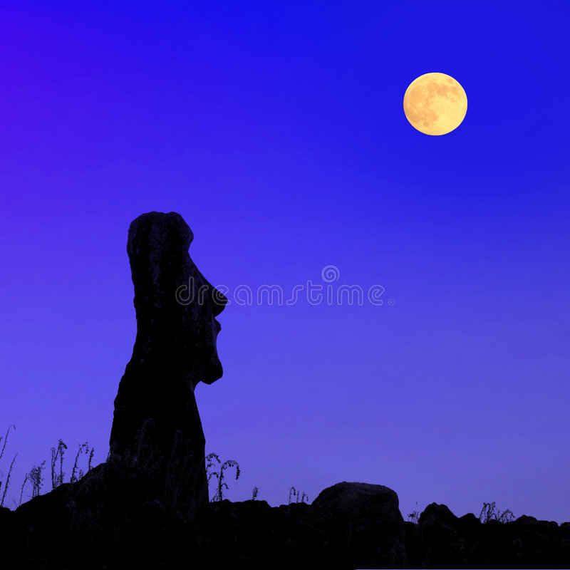 Easter island at full moon stock photography