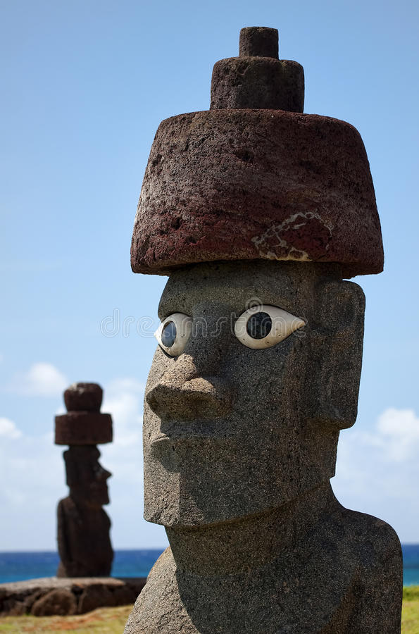 Easter Island - old statues moai on the waterfront royalty free stock photo