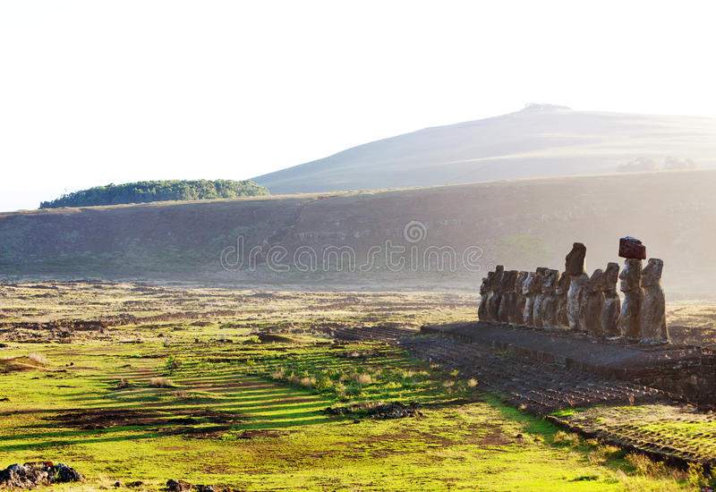 Easter Island statues in morning light. Easter Island moai in Ahu Tongariki in sunny morning light royalty free stock photo
