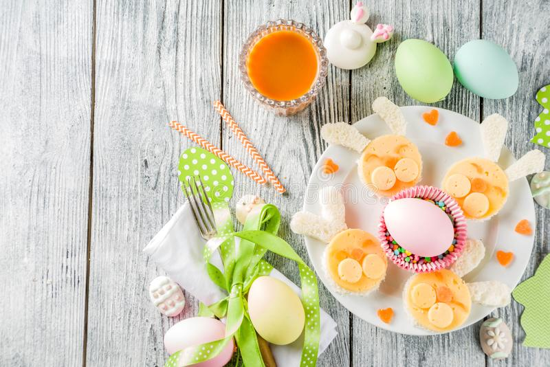 Easter kids breakfast with rabbit sandwiches stock photos