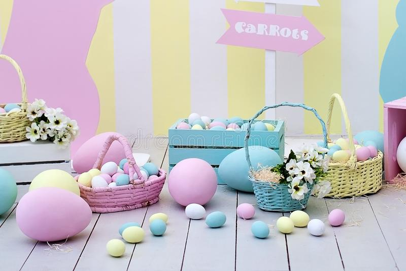 Easter and spring decor. Large multi-colored eggs and Easter bunny. royalty free stock image