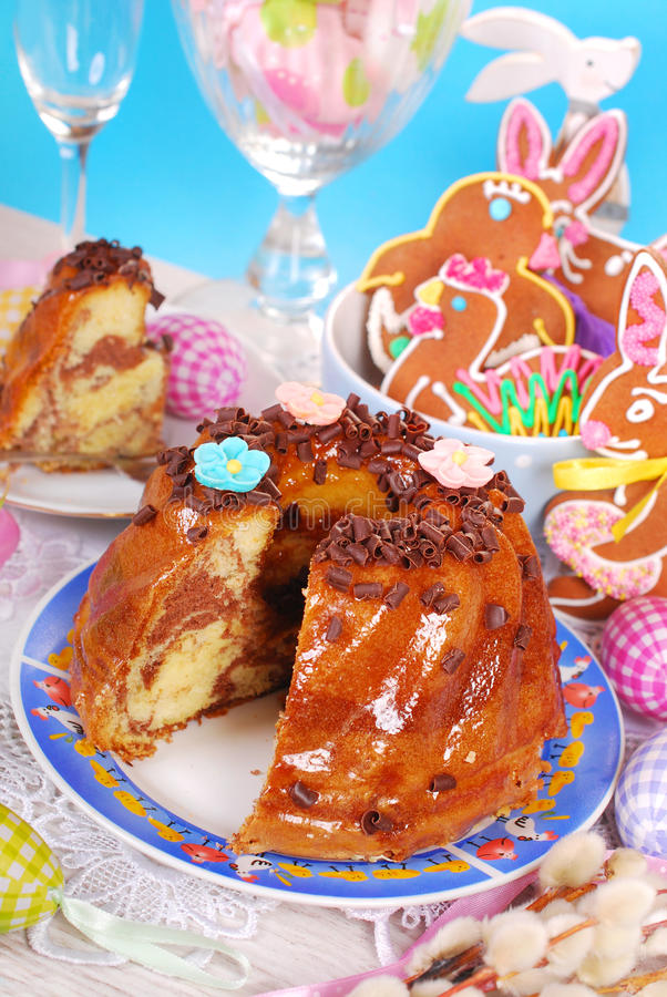 Easter marble ring cake with chocolate flakes. Marble ring cake with chocolate flakes on easter table royalty free stock image