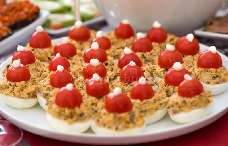 Easter food, stuffed eggs plate. Easter meal, party food, a plate of stuffed eggs with cherry tomatoes royalty free stock image