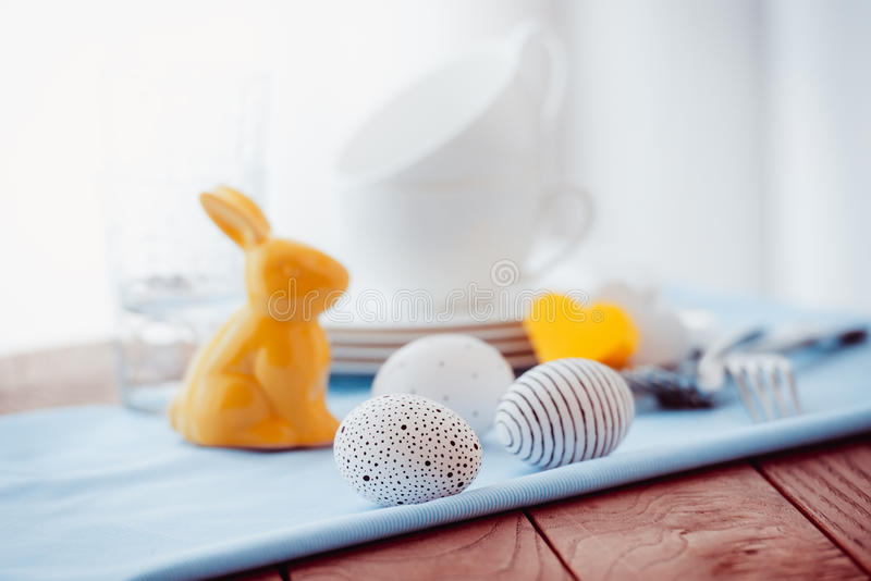 Easter. Modern painted easter eggs on wooden table stock photography