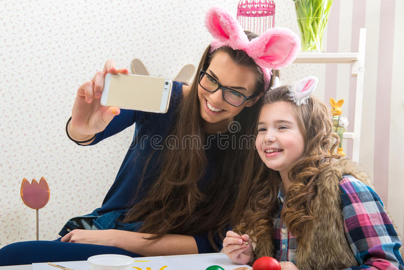 Easter - Mother and daughter with bunny ears, made Selfie photo stock photography