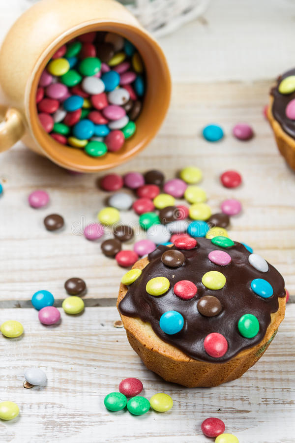 Easter muffins with candies and chocolate glaze royalty free stock photos