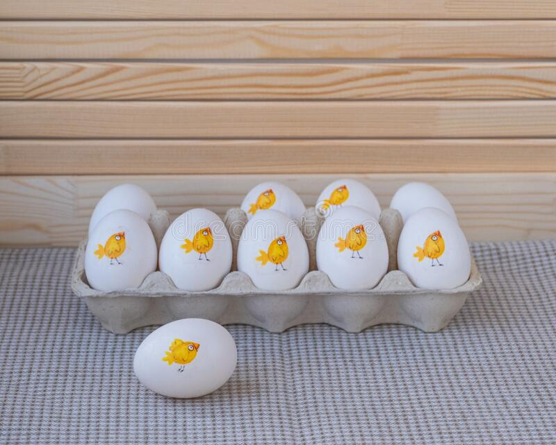 Easter natural eggs decorated using decoupage technique. Funny decoration. Cute chickens. Easter natural eggs decorated using decoupage technique. Tray and one royalty free stock image