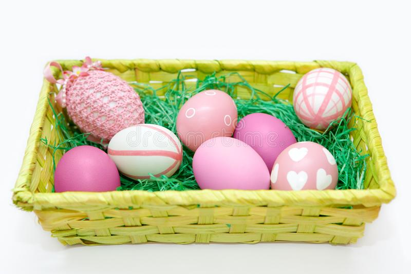 Easter nest with pink eggs on white background stock images