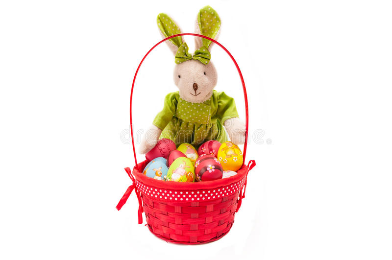 Easter painted eggs in basket with bunny stock image