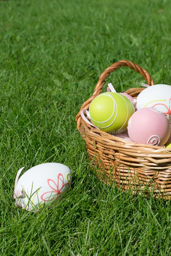 Easter painted pastel color eggs with ribbon on green grass. Sunny day. Close up. Selective focus. stock images