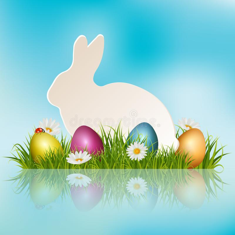 Easter paper bunny in grass royalty free stock photography