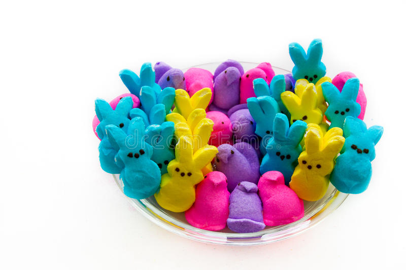 Easter Peeps. Easter bunnies and peeps in pink, blue, yellow and purple on white background royalty free stock photography