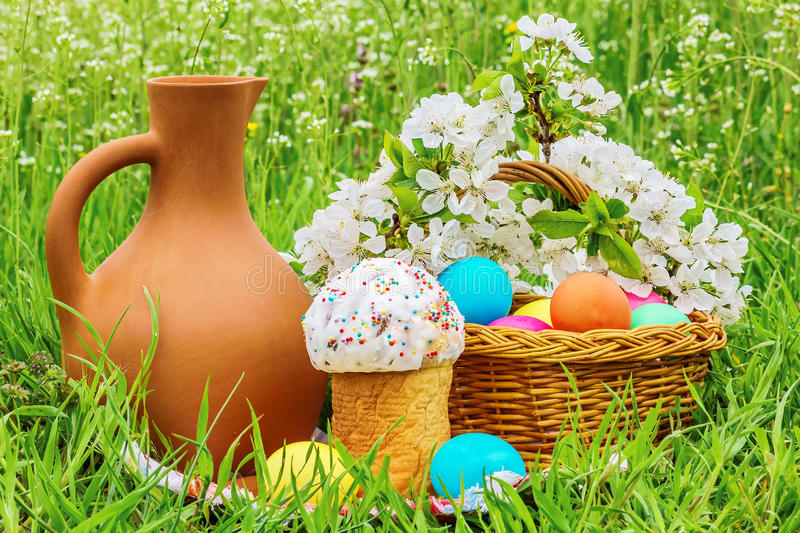 Easter picnic on the flowered meadow stock images