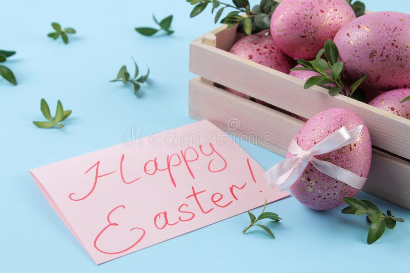 Easter. Pink Easter eggs in a box on a trendy blue background. Happy easter. holidays. close-up stock photos