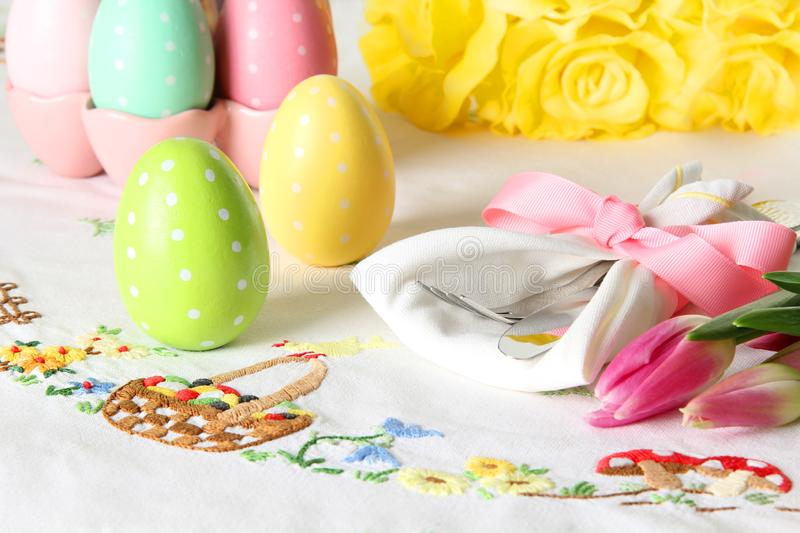 Easter place setting on an elegant linen table cloth. This traditional holiday brunch place setting includes painted eggs, an stock images