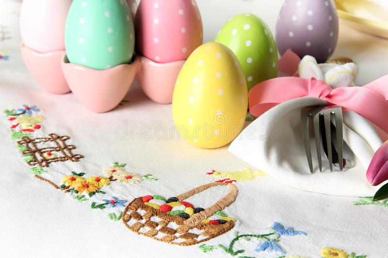 Easter place setting on an elegant linen table cloth. This traditional holiday brunch place setting includes painted eggs, an stock image