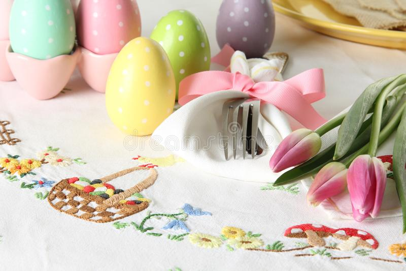 Easter place setting on an elegant linen table cloth. This traditional holiday brunch place setting includes painted eggs, an royalty free stock photo