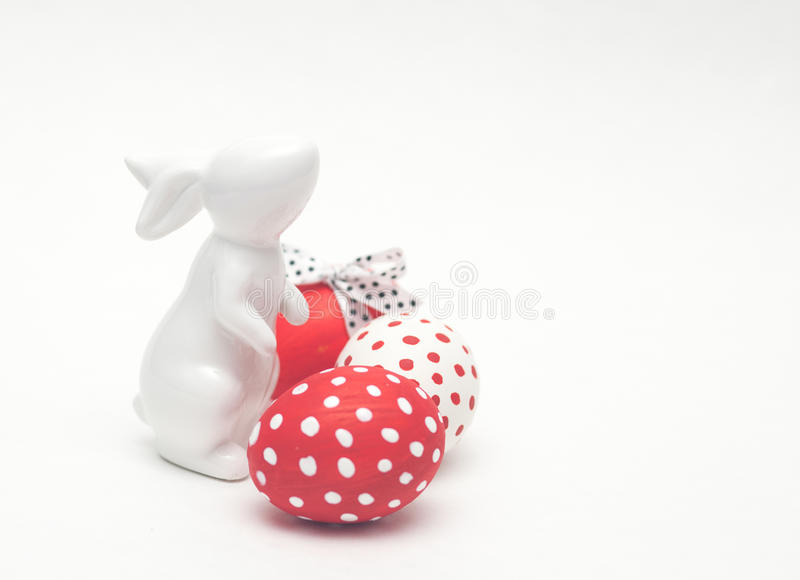 Easter porcelain bunny with eggs stock photo