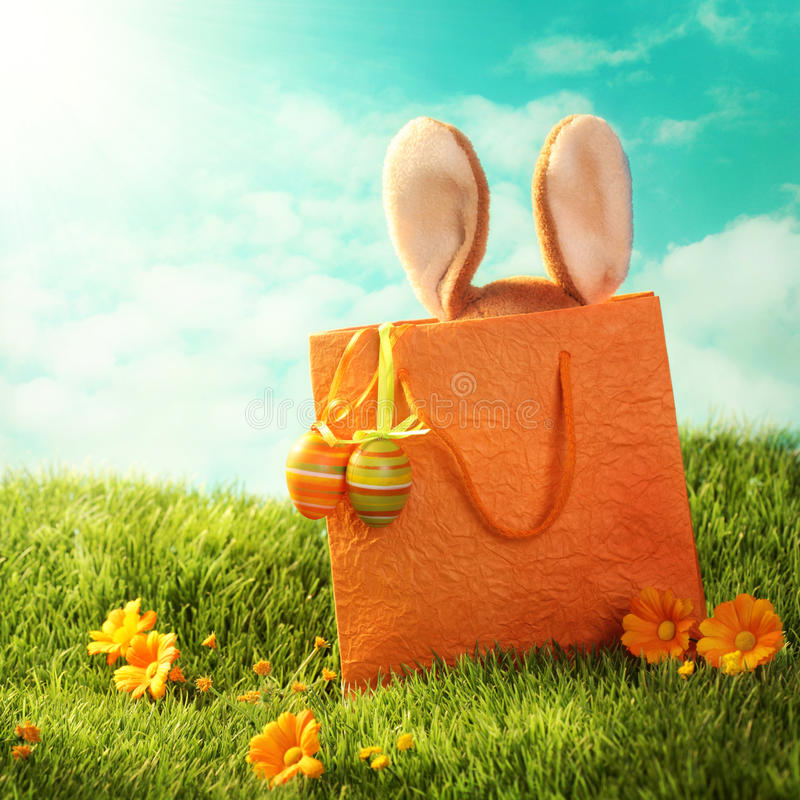 Easter present. With rabbit and easter eggs stock photo