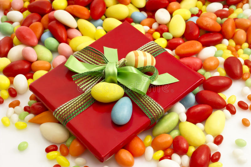 Easter present with ribbon and easter eggs, sugar eggs stock photos