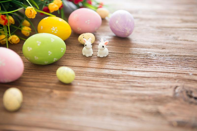 Easter rabbit with Easter eggs on wooden background. Close-up stock image