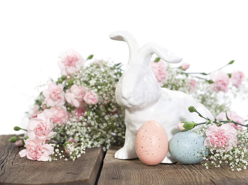 Easter Rabbit with Pink Carnations royalty free stock images