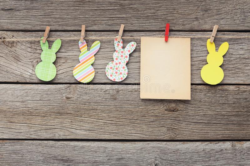 Easter rabbits and blank paper with copy space royalty free stock photos