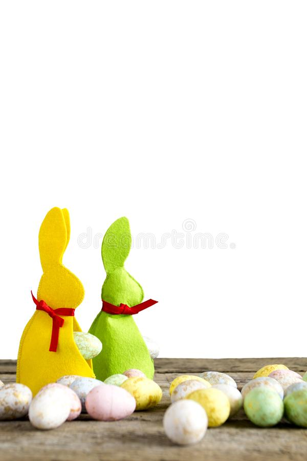 Easter rabbits on old wooden table with eggs isolated on white. stock image