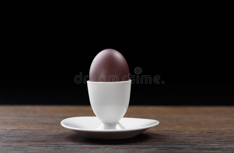 Easter red-brown egg stock photo