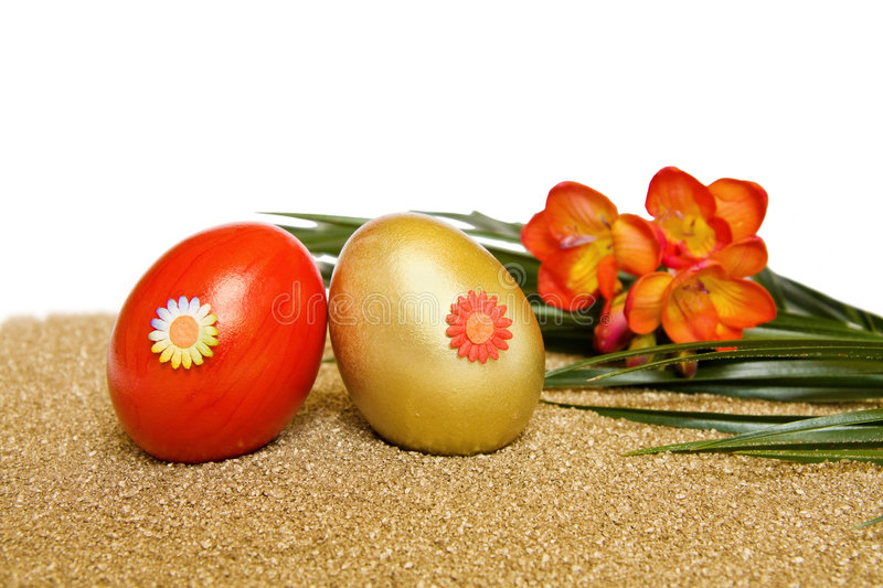 Easter Red And Golden Eggs With Freesia Flower Royalty Free Stock Photo