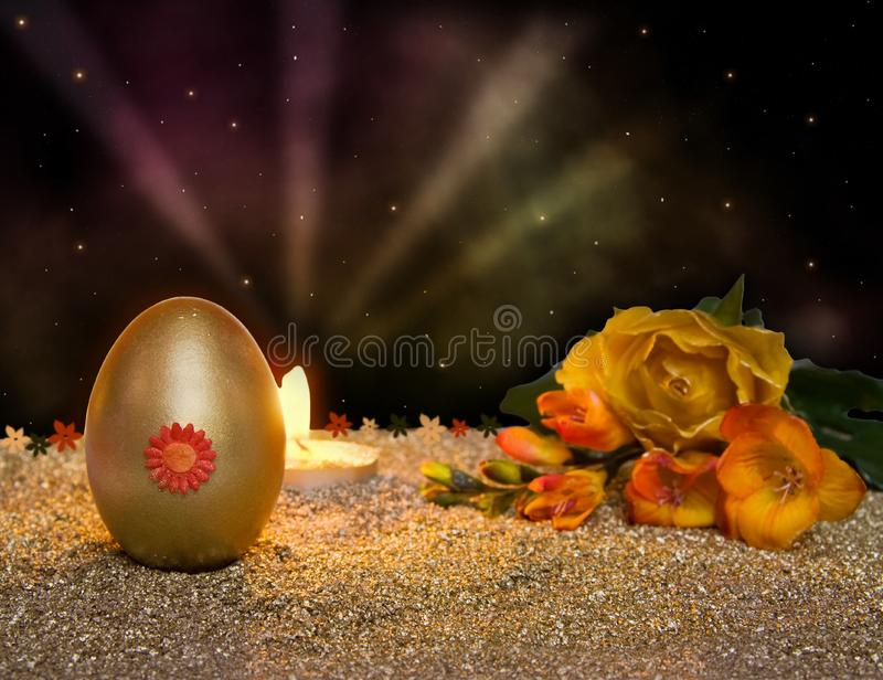 Easter resurrection candle with golden egg