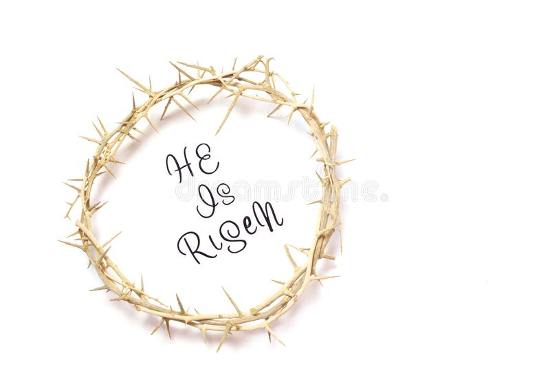 Easter He is Risen Quote isolated on white background with Crown. Of Thorns with room for text royalty free stock photo