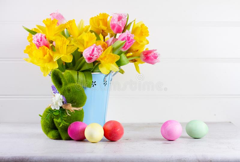 Easter scene with colored eggs stock images