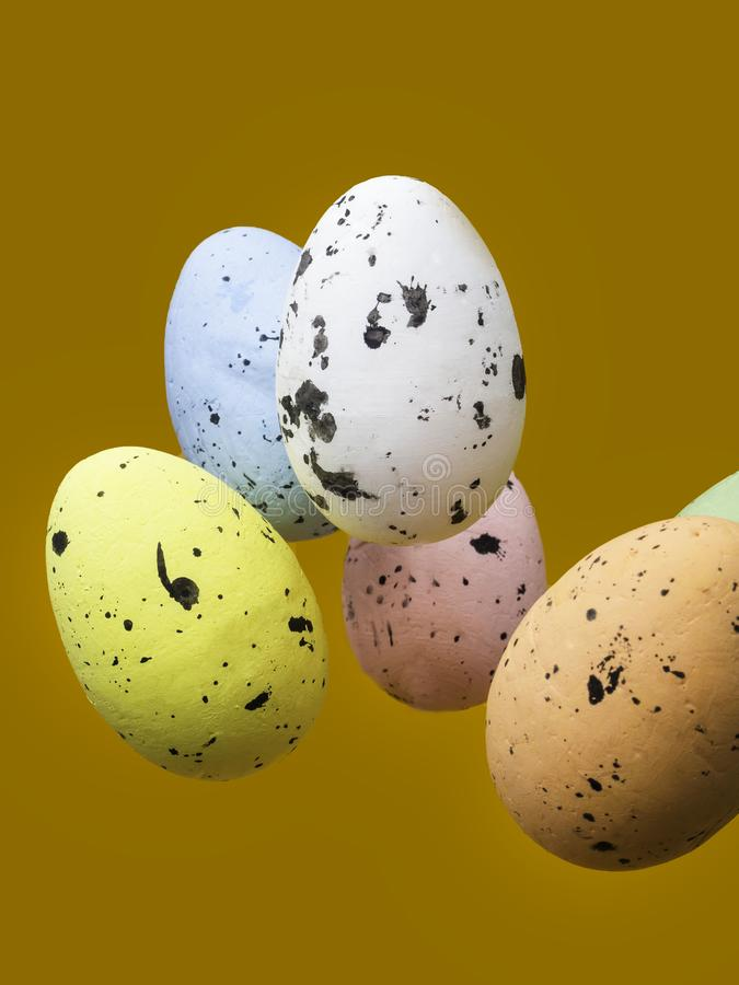 Easter scene with flying color eggs stock images