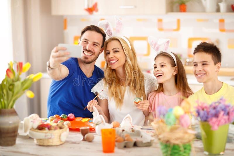 Easter selfie together. Family Easter selfie together in kitchen stock images