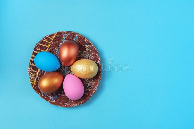 Easter set of colored eggs on bright blue background Easter holiday decorations royalty free stock photos