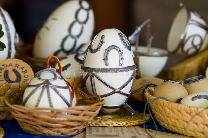 Easter shod eggs. On basket stock photography
