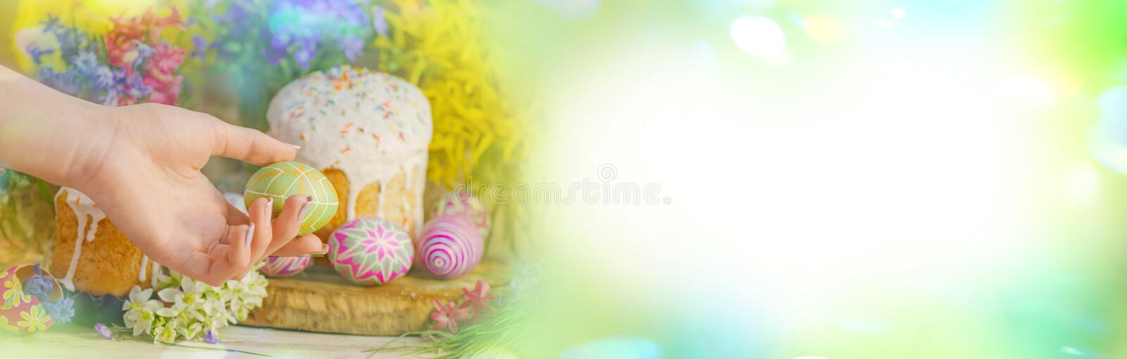 Easter spring concept. Table decorating for Easter holiday. Easter eggs on meadow with flowers royalty free stock image