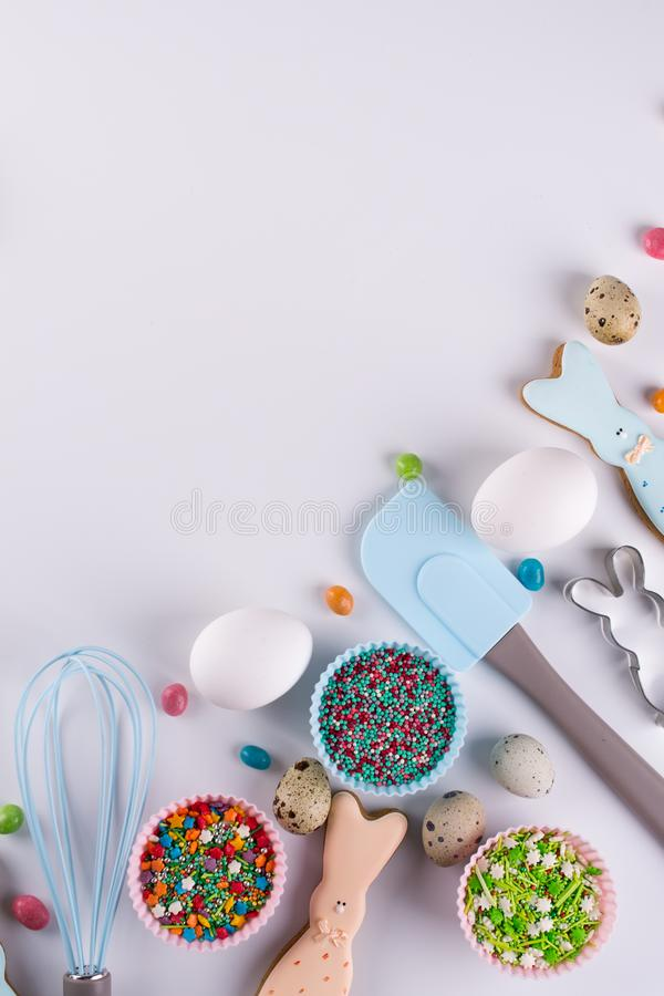 Easter spring decorative composition. Making homemade sugar cookies. Biscuit in the shape of a funny rabbit , tools necessary stock photo