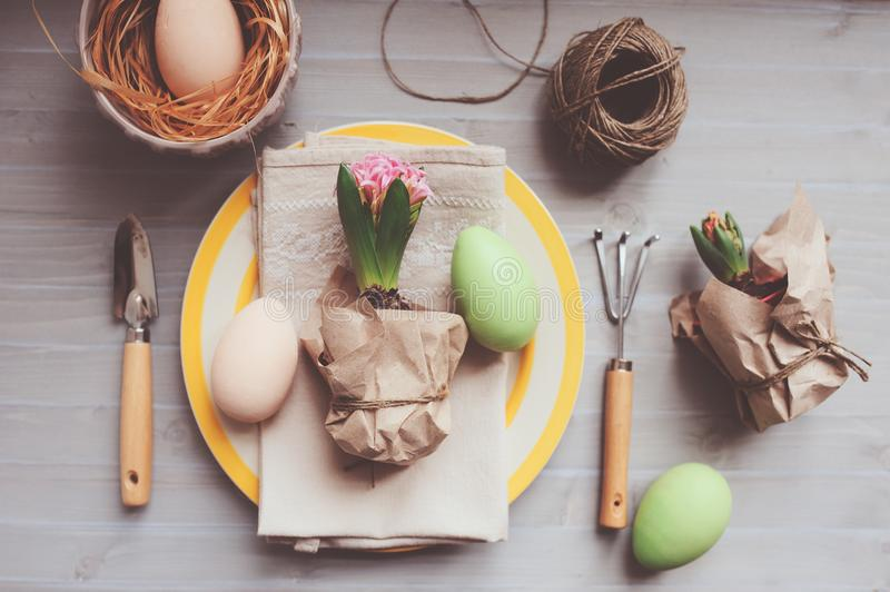 Easter and spring preparations. Hyacinth, eggs and garden tools on table, top view. Selective focus, cozy home interior royalty free stock photo