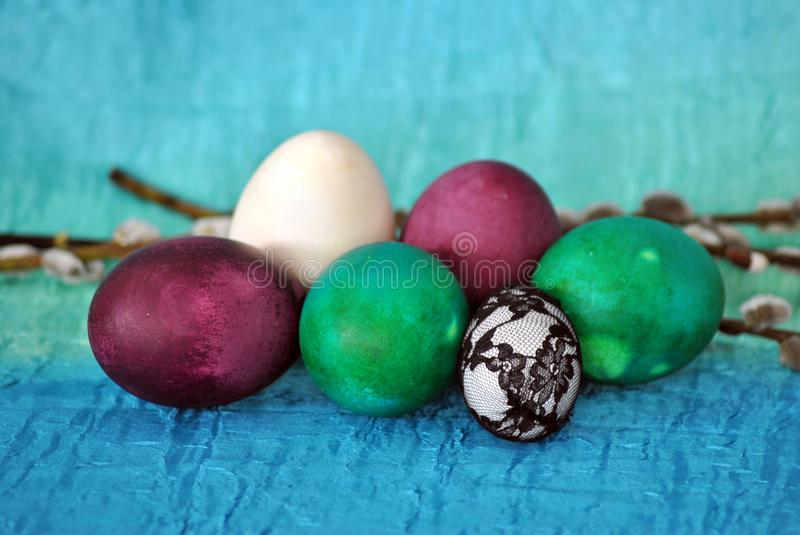 Easter still life with turquoise cloth royalty free stock image
