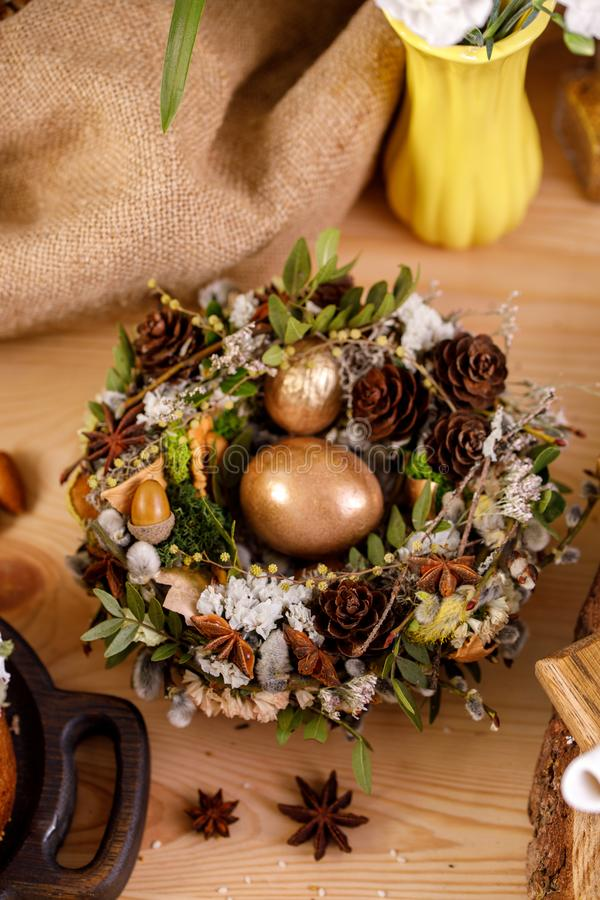Easter still life. Wicker nest with eggs on a wooden saw. Traditional celebration concept stock image