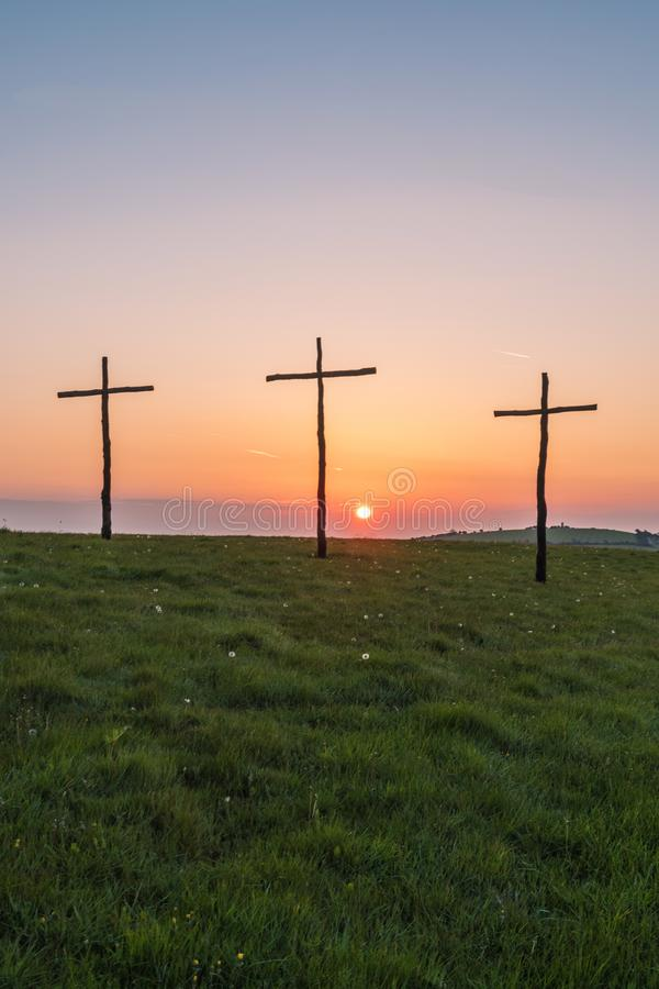 Easter sunrise on crosses or crucifix. Easter sunrise on crosses and crucifix on green fields or rolling hills and downland stock photos