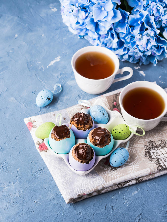 Free Easter Sweet Cup Cakes Treets In Colorful Egg Shells On Blue Stock Image - 89766581