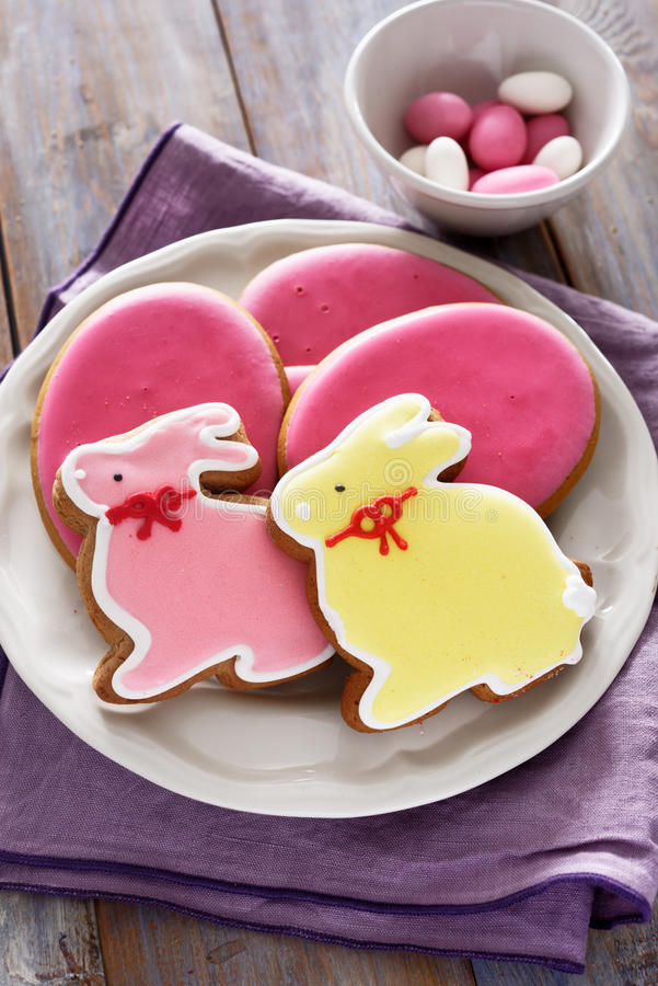Easter sweets on a rustic table royalty free stock images