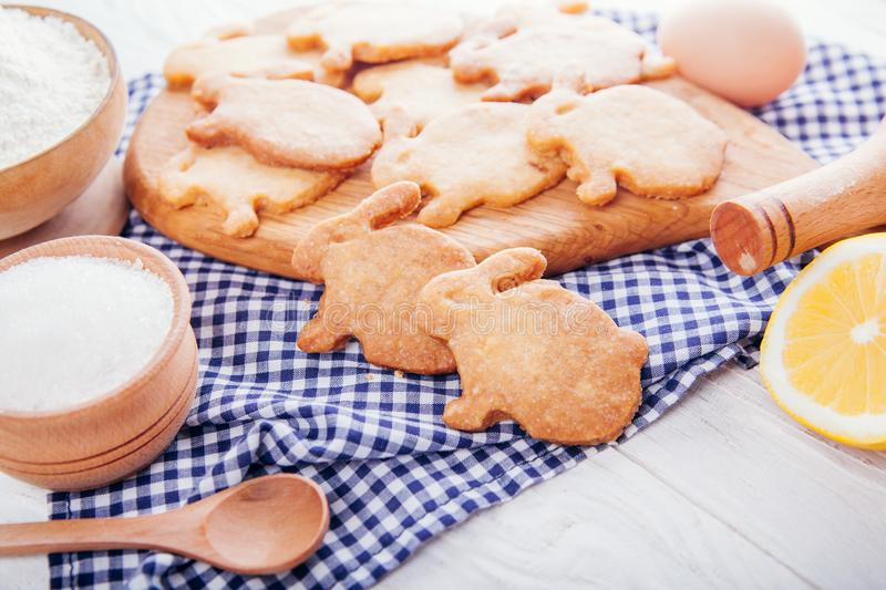 Easter symbol concept. Baking Easter cookies bunny-shaped Home-made food. Easter symbol concept. Biscuits with ingredients. Baking Easter cookies bunny-shaped stock image