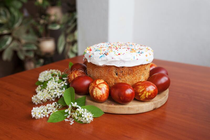Easter symbols food - Easter cake and painted eggs. Easter orthodox sweet bread, kulich and colorful quail eggs. Holidays royalty free stock photography