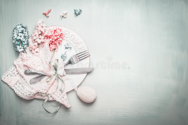 Easter table setting in blue pink pastel color with lovely flowers and decor egg, top view royalty free stock image